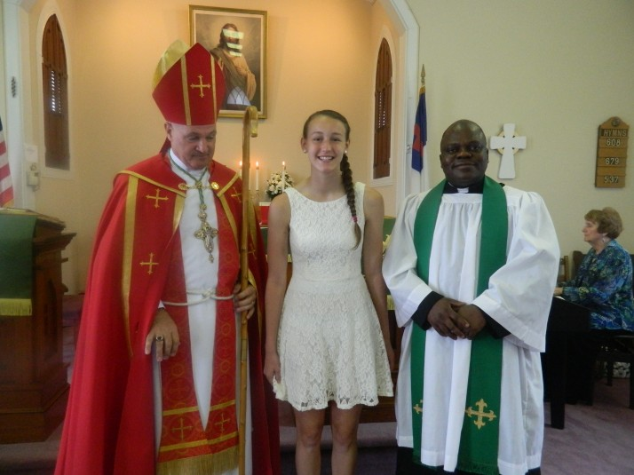 The Bishop, Julie, and Father Pothin standing together